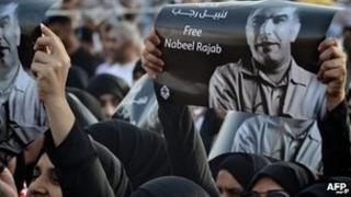 Protesters in Bahrain hold up a picture of human rights activist Nabeel Rajab at a rally south of the capital Manama on May 11.