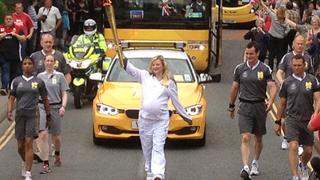 Pregnant mother Hayley Lynch with the torch in Welshpool Photo: Iolo ap Dafydd