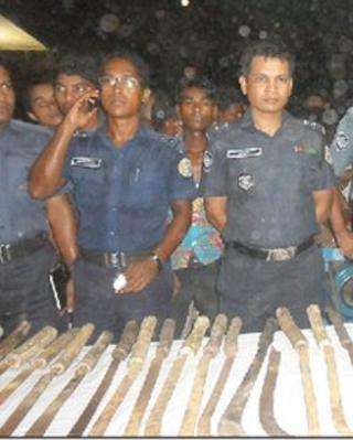Police with weapons allegedly used by the thieves