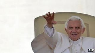 Pope Benedict XVI waves during his weekly general audience