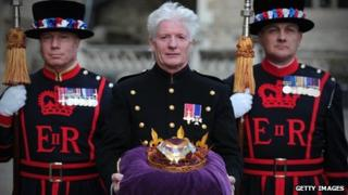 Bruno Peek with a diamond which will help the Queen light a beacon