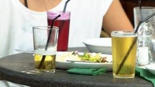 Person sitting at a table with drinks