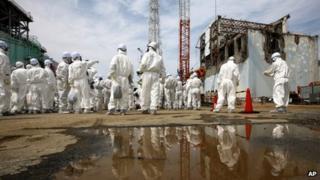 People in protective suits at Fukushima