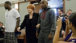 Floyd Mayweather Jr (right) walks into court escorted by his attorney Karen Winckler, center, and 50 Cent, left, to begin his 90-day jail term, June 1