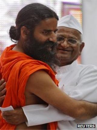 Indian yoga teacher Swami Ramdev (L) hugs veteran social activist Anna Hazare during their day-long hunger strike against corruption in New Delhi June 3, 2012.