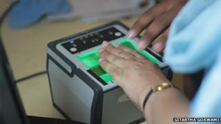 Fingerprints being taken at a biometric identity number centre in India
