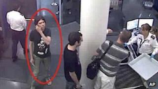 A surveillance image provided by Interpol shows who authorities believe is Luka Rocco Magnotta at a security checkpoint area