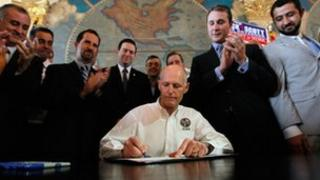 Gov Rick Scott signs anti-Cuba law, May 1 2012