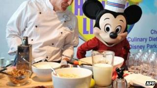 Mickey Mouse and a chef prepare food in Washington. Photo: 5 June 2012