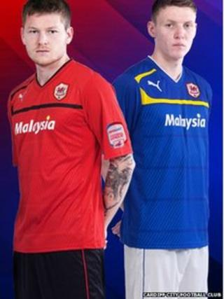 Midfield Around Gunnarsson in the new red home shirt and striker Joe Mason in Cardiff's new blue away strip.