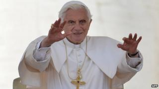 Pope Benedict XVI blesses people at a General Audience