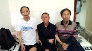 """Li Wangyang (L) posing for a photo with his friends in Shaoyang, in central China""""s Hunan province, June 2012"""