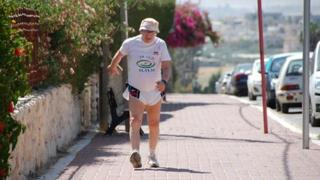 Shaul Ladany taking part in a 76km walk to mark his 76th birthday, in the town of Omer, near Be'er Sheba