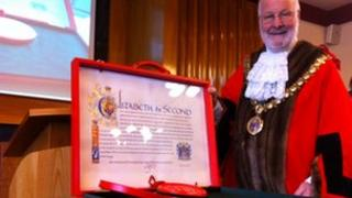 Letters patent with mayor Christopher Kingsley