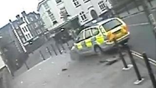 Police car crashing through metal roadside posts in Norwich