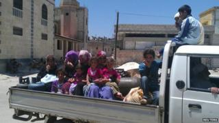 Family fleeing home in Syria