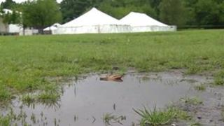 Puddles and tents at Peel Park