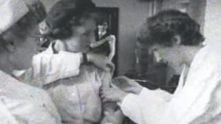 Woman having vaccination
