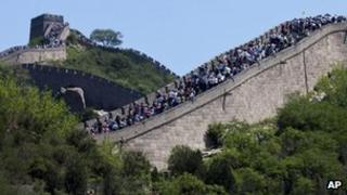 Tourists go sightseeing on the Great Wall of China during a weekend at Badaling June 2 2012