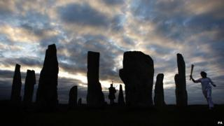 Commonwealth gold medallist Kirsty Wade took the flame to the Callanish Standing Stones as the sun rose