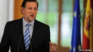 Spanish Prime Minister Mariano Rajoy addresses the media at the Moncloa palace