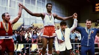 Cuban champion Teofilo Stevenson (centre- gold medal), Soviet Pyotr Zaev (left-silver medal) and German Democratic Republic's Jurgen Fanghanel (right - bronze medal) on the podium at the Moscow Olympics