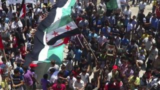 Demonstrators take part in a protest against Syria's President Bashar al-Assad in Sermeen, near the northern city of Idlib on 8 June 2012