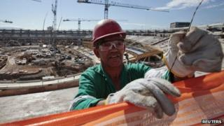 A worker at the Maracana Stadium in Rio de Janeiro on 11 June 2012