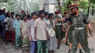Tamil children in Sri Lanka being lined up by police
