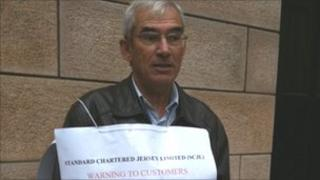 George Burrow protesting outside Standard Chartered