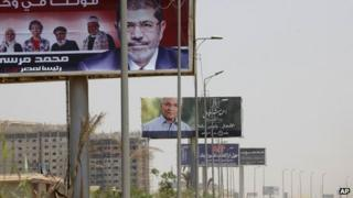 Posters for Mohammad Mursi (foreground) and Ahmed Shafik, Cairo