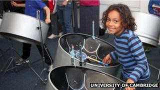 Child playing steel drums