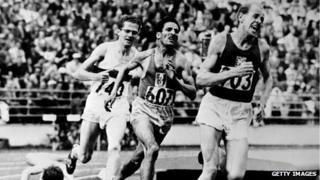 Emil Zatopek in front of Alain Mimoun and Herbert Schade during the Olympic 5000m in Helsinki in 1952