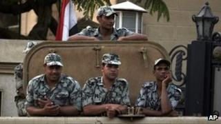Egyptian soldiers stand guard in Cairo, Egypt, Monday, May 28, 2012.