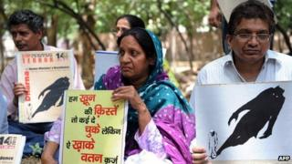 Civil rights activists protest outside Home Minister P Chidambaram's home in Delhi on 14 June 2012