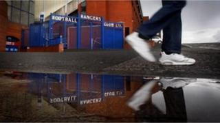 Man walking past Ibrox