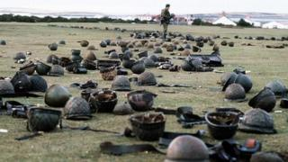 Argentinian helmets on ground after battle for Goose Green