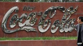 A man walks by a Coca-Cola plant in Taiyuan, northeast China's Shanxi province 30 April 2012