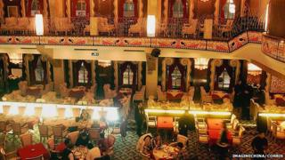 Customers take dinner in the Paramount Hall in Shanghai