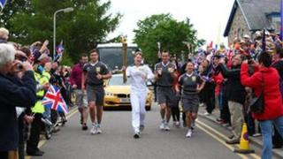 The Olympic Flame on the Torch Relay leg between Grantown-on-Spey and Tomintoul - Day 24