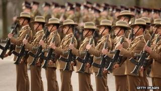 Soldiers in The Queen's Gurkha Engineers stand to attention
