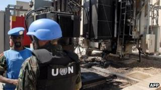 UN observers inspect a power station allegedly attacked by rebels in Qaboun, Damascus. Photo: June 2012