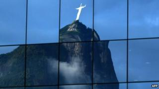 Christ the Redeemer statue reflected in the windows of a business building (15 June 2012)