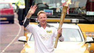 Paul Collingwood carries the torch through Durham