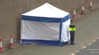 Police tent near scene of incident