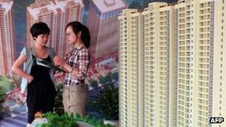 A buyer looking at property broacher in China
