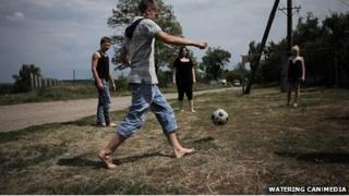 Members of the Street Child World Cup Ukraine team play football