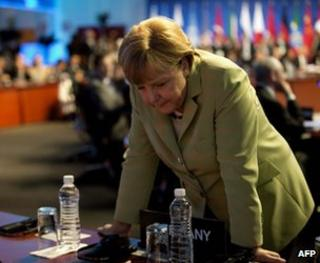 German Chancellor Angela Merkel consults colleagues at the G20 summit in Los Cabos, Mexico, 18 June