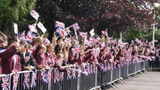 Pupils from Selby High School await the torch's arrival