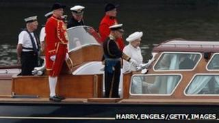 The Queen's launch makes its way down the river